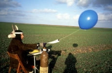 MEASURABLE LOSS OF WATER DURING A BIRDS' FLIGHT_______typing about water loss in a reclaimed landscape, littered with sea shells. the text send skyward with a helium balloon / Flevoland Netherlands / 1994
