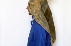 A POSE FOR A DRY PHOTOGRAPH OF RAIN_______rain jacket , latex sea turtle / 1992
