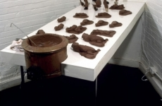 CHOCOLATE SOLILOQUY_______chocolate fetal goat casts, dried goat ears, alarm clock dipped in chocolate / 1989