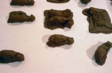 CHOCOLATE SOLILOQUY_______chocolate fetal goat casts, dried goat ears, alarm clock dipped in chocolate/ 1989