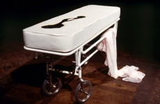 SLEEPING WITH CHOCOLATE_______autopsy table a self-contained unit, where chocolate is pumped to the surface and returns through a middle drain/ 1996