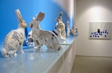 PHARMACEUTICAL LANDSCAPE_______30 x 500 cm / melted pill bottles in the form of Easter bunnies, glass