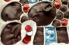 UNIDENTIFIED. RUSSIAN MORGUE CHOCOLATES_______impressions from wounds cast in dark chocolate / 44 X 48X 8 cm / 1994